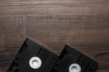 old retro video tape on wooden background