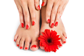 Woman with beautiful red manicured nails