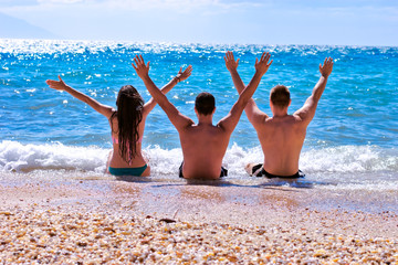 Young people enjoy on beach