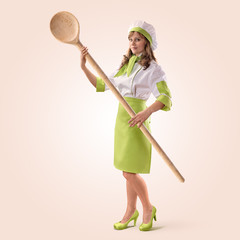 cook girl with a big wooden spoon