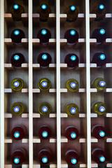 shelves with wine bottles at  cafe