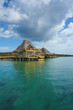 Caribbean resort overwater with thatched roof