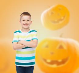smiling boy over pumpkins background