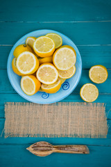 Organic lemons  halves and juice squeezer on table