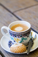 Cup of freshly brewed coffee and a cookie