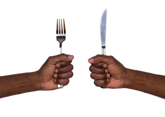 Man holding fork and knife