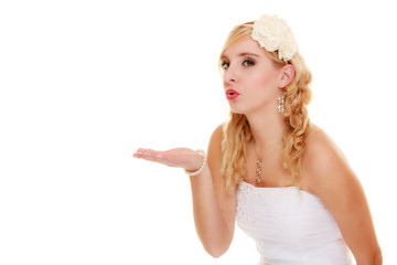 Wedding. Young woman romantic bride blowing a kiss