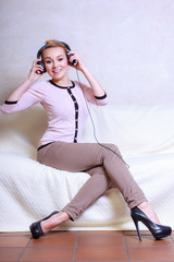 Modern woman with headphones listening to music