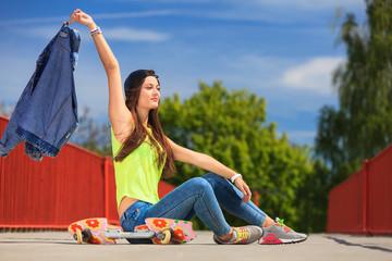 Summer sport. Cool girl skater with skateboard