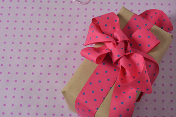 gift box with ribbon and bow, pink and blue polka dot