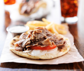 open greek gyros with tzatkiki sauce and fries