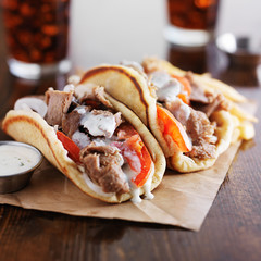 authentic greek gyros with tzatkiki sauce, cola and fries