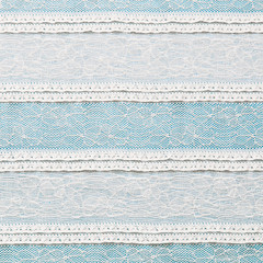 Ivory lace fabric on blue background