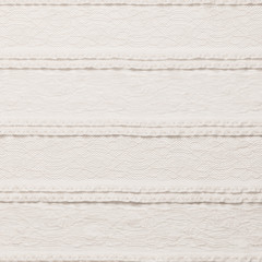 Ivory lace fabric on white background