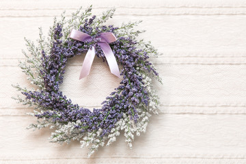 Wreath with lavender flowers on lace fabric background