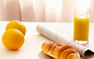 Croissants, Coffee, Orange Juice and Newspapers