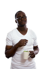African man with cup of tea, isolated on white