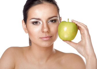 Young beautiful woman eating green apple isolated over white