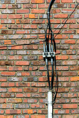 Electric wire on brick wall
