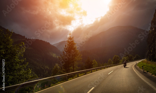 Motorcyclist in action in sunset light - 70743872