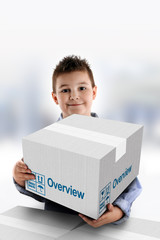 Boy holding a cardboard box on which was written Overview