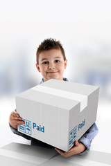 Boy holding a cardboard box on which was written Paid