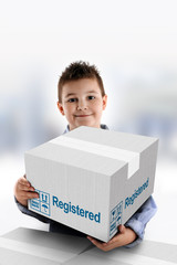 Boy holding a cardboard box on which was written Registered