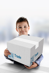 Boy holding a cardboard box on which was written Trade