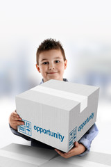 Boy holding a cardboard box on which was written Opportunity