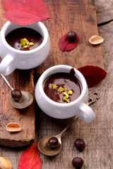 flavored hot chocolate in small ceramic chashkahna wooden table