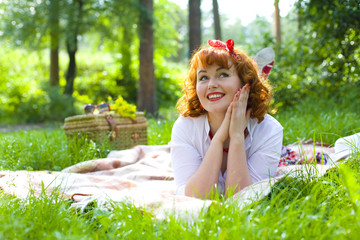 Portrait of pin-up girl in a summer forest