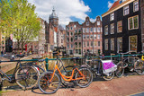Amsterdam city with bikes on the bridge in  Holland