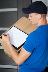 Delivery man holding a parcel