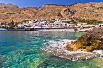 Small harbor with village at south side of Crete island
