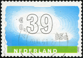 Stamp of the Netherlands with an abstract, colour background
