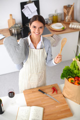 Woman making healthy food standing smiling in kitchen