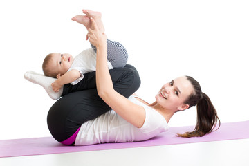 mother with child do gymnastic and fitness exercises
