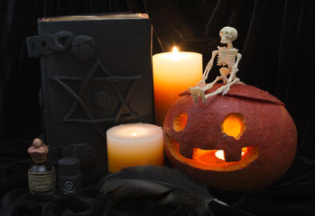 Halloween still life with magic objects and skeleton