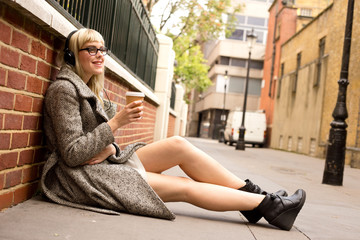 young woman relaxing with coffee and music.