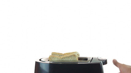 Man hand putting bread into toaster