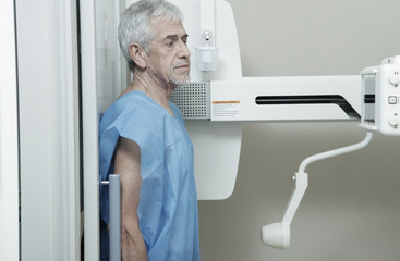 Man in 70s undergoing x-ray scan