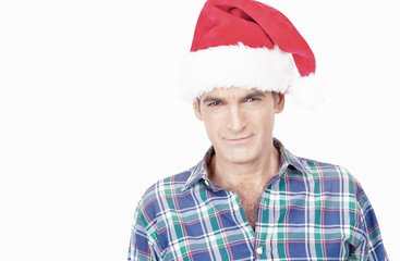 Angry but smiling man in shirt with Santa hat. Isolated on white