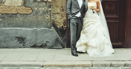 Wedding couple walking on the street