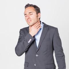 Geschäftsmann leidet unter Halsproblemen