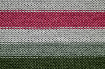 Knit woolen texture. Fabric striped background