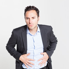 Businessman suffering from stomachache