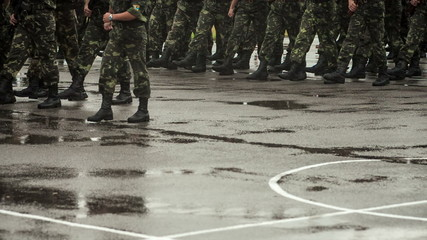 Soldiers marching in the rain