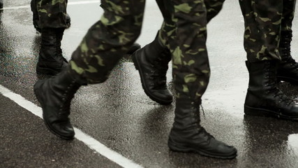 Soldiers marching in the rain on parade ground