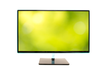 Monitor with an image of a blurred green natural background