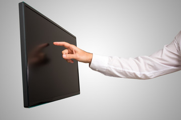 Man navigating a touch screen computer monitor